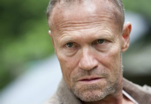 Michael Rooker as Merle Dixon
