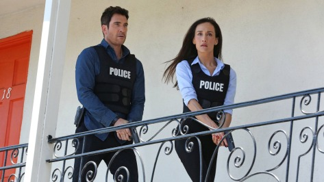 Dylan McDermott and Maggie Q hunting stalkers.  Source: Provided