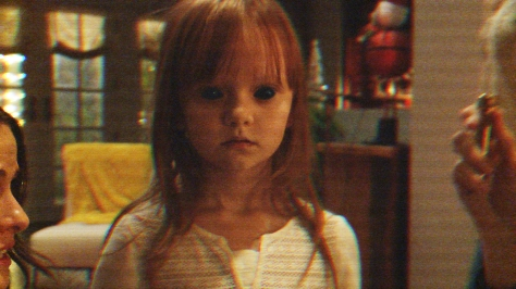Leila (Ivy George) is the target for demon Toby